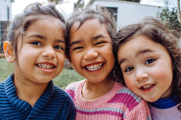 3 young girls smiling